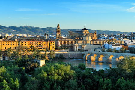 spain: evening view of Mosque-Cathedral and Romano Bridge, Cordoba,Spain