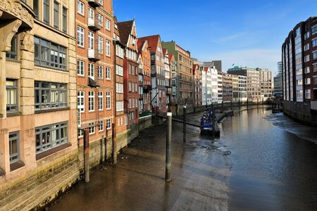 separates: Historic timber-framed houses at Nikolaifleet, Altstadt district, Hamburg, Germany. Nikolaifleet  separates the Cremon island from the mainland. The Nikolaifleet is one of the oldest parts of the port of Hamburg.