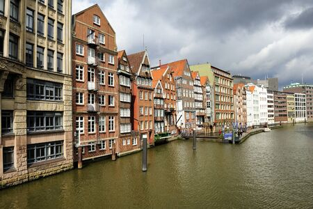 altstadt: historic timber-framed houses at Nikolaifleet, Altstadt district, Hamburg, Germany. Nikolaifleet  separates the Cremon island from the mainland. The Nikolaifleet is one of the oldest parts of the port of Hamburg. Editorial