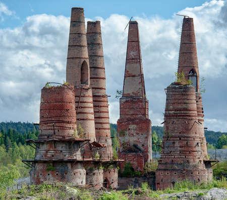 old broken brick pipes of kilns at abandoned marble factory in Ruskeala, Karelia, Russia