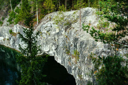 view of canyon and lake in abandoned marble quarry in the Ruskeala Mountain Park, Karelia, Russia