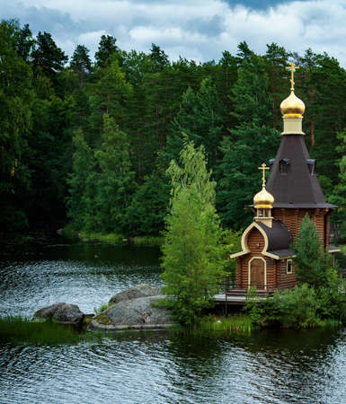 wooden ortodox church of the Apostle Saint Andrew the First Called at a lake island in Russia