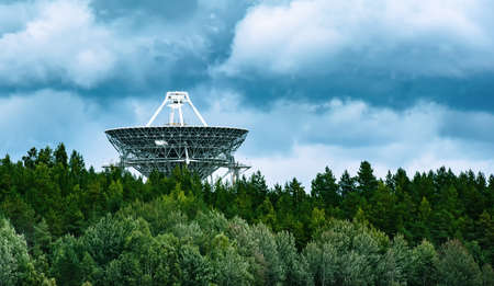 listening the sky - radiotelescope antenna in maintenance during the day in the forest 스톡 콘텐츠