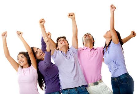 gente celebrando: Feliz grupo de amigos con los brazos arriba - aislados en un fondo blanco