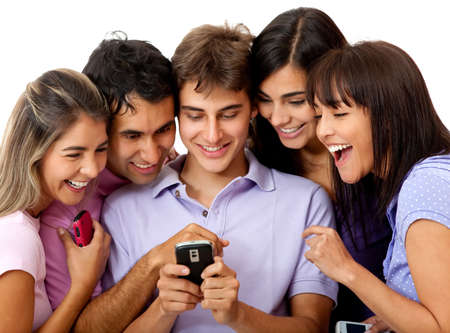 sms text: Group of people social networking on a cell phone - isolated over white