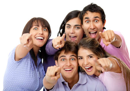 joking: Surprised group of friends pointing to the camera - isolated over white Stock Photo