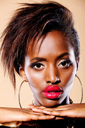 Fashion of a black womanÕs portrait with big red lips   photo