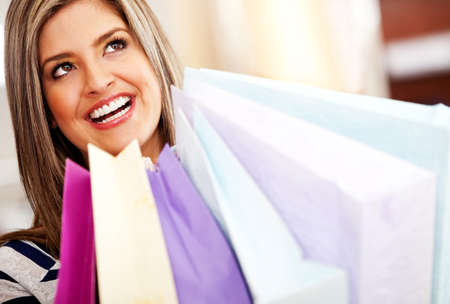 Beautiful happy shopping woman in a mall Stock Photo - 11291978