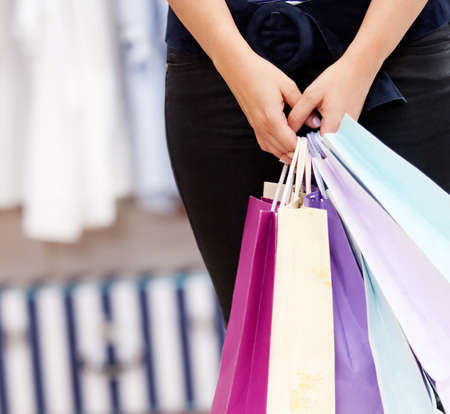 female person holding a shopping bags in a store photo