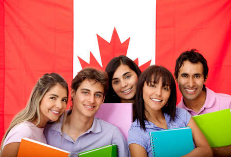 canada: Group of English or French students with the flag of Canada