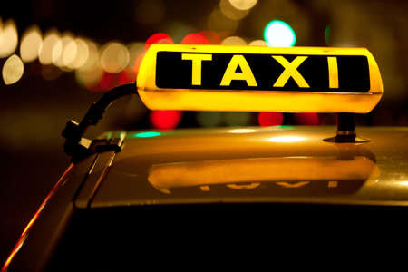 taxi cab: Taxi cab sign on top of the vehicle at nighttime