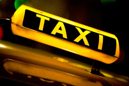 Taxi cab at night with the sign lit  photo