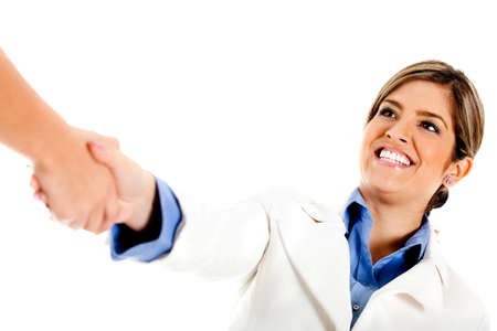 Woman giving a business handshake - isolated over a white background photo