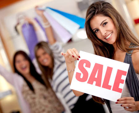 Group of beautiful women shopping on sale at a retail store