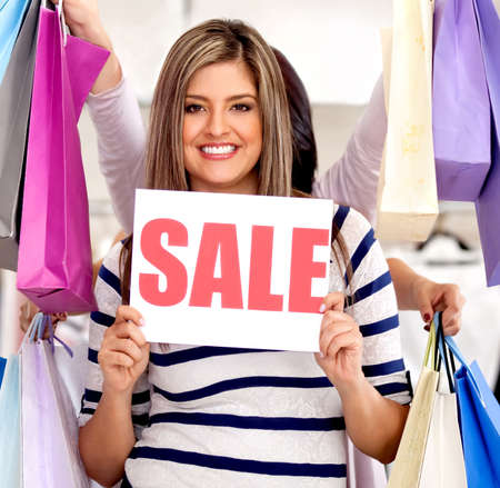Woman shopping on sale looking happy and smiling 