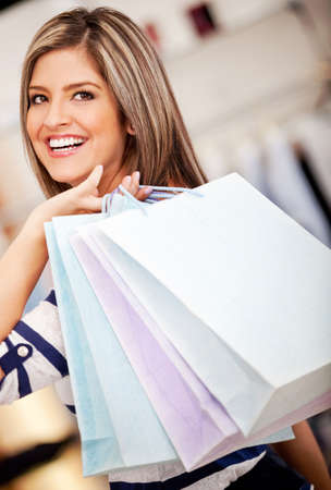 Woman holding shopping bags at a retail store  Stock Photo - 11292021