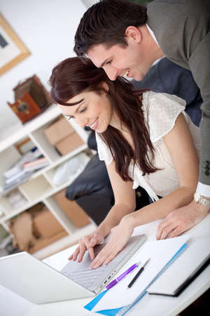 Business couple working at the office looking happy photo