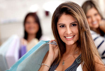 Group of beautiful women shopping and holding bags  photo
