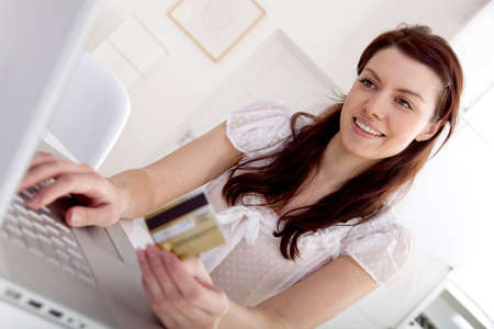 method: Woman shopping online from home on her laptop computer Stock Photo