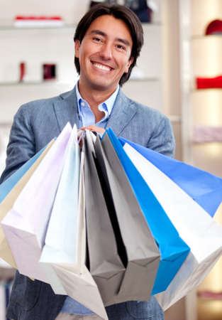 Man holding shopping bags at a retail store  photo