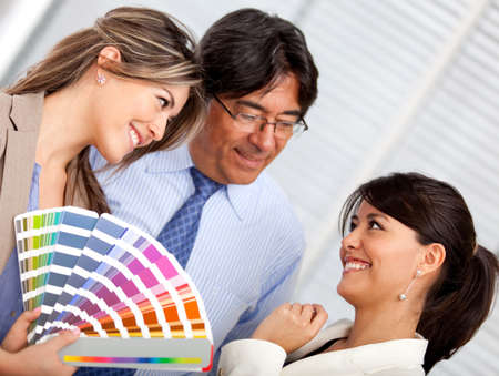 redecorating: Business people with an interior designer redecorating the office
