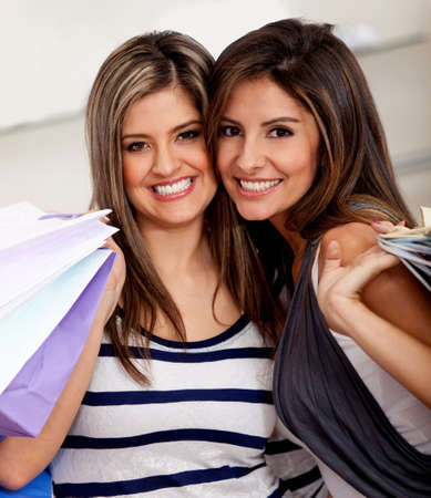 Beautiful shopping women at the mall holding bags  photo
