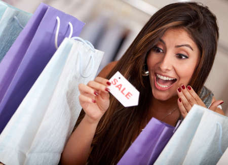 exciting: Beautiful woman at an exciting shopping sale