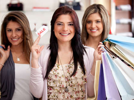 Group of beautiful women at the mall shopping on sale  photo