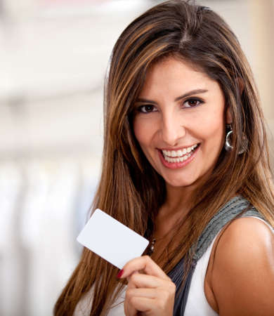 debit: Happy woman holding a credit or debit card and smiling