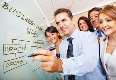 workflow: Corporate group drawing a business plan on the board