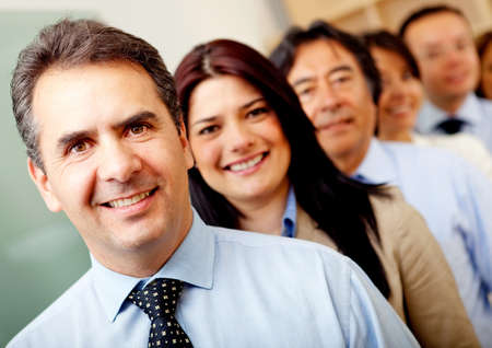 Group of business people lead by a man at the office  Stock Photo - 11465769