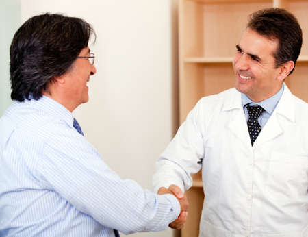 the medic: Business man making a successful sele to a doctor and handshaking