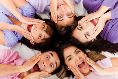 Surprised group of people lying on the floor  photo