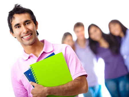 Male student holding notebooks with group at the background photo