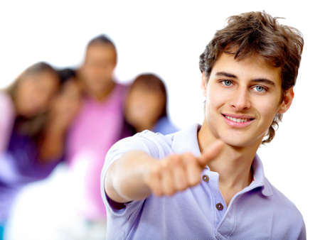 Young man with thumbs up and a group behind - isolated over a white background photo