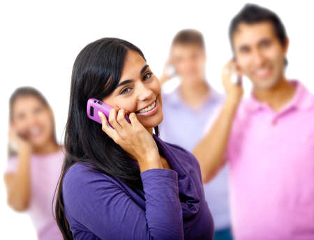 Woman talking on the phone with a group - isolated over a white background photo