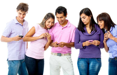 Group of young people texting on their cell phones - isolated over a white background photo