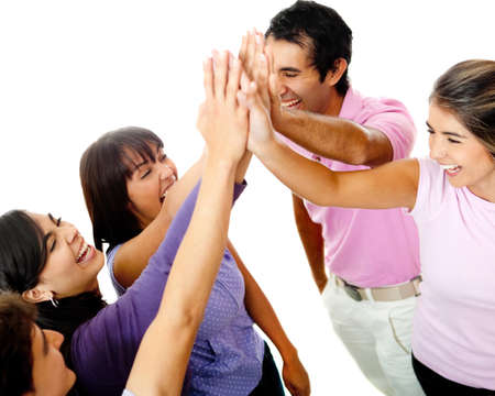 shake up: Happy group of young friends giving a high-five isolated over a white background