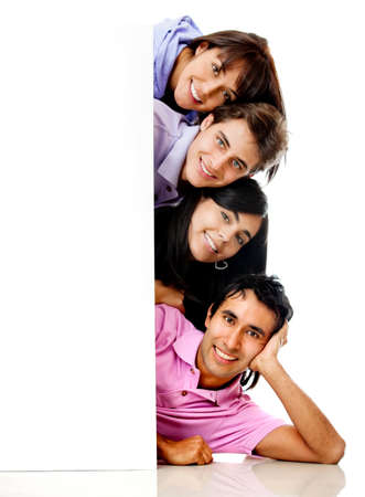 Group of happy people with a banner smiling - isolated over a white background photo