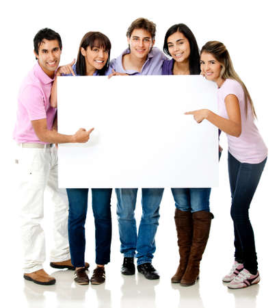 Group of casual people pointing at a banner - isolated over a white background photo