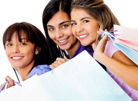 Group of women holding shopping bags - isolated over a white background photo