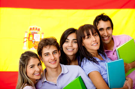 student travel: Spanish students with the flag of Spain at the background