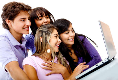 Group of friends studying on a laptop computer - isolated over a white background photo
