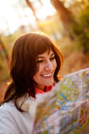 Female explorer holding a map at the countryside  photo