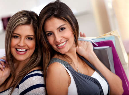 Beautiful female shoppers at the shopping center  photo