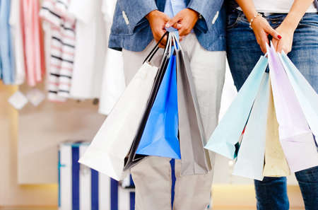 Couple holding shopping bags in a store  Stock Photo - 11466676