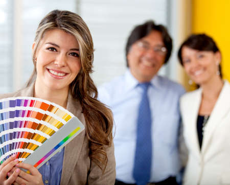 redecorating: Couple with an interior designer redecorating and choosing colors to paint