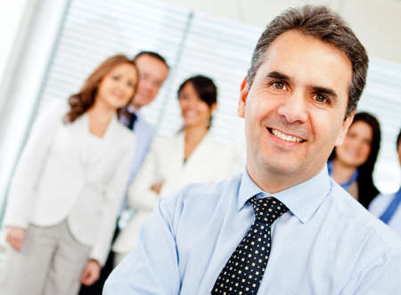 employers: Successful business leader with a group on the background