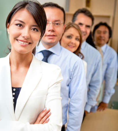 executives: Business people lead by a female at the office  Stock Photo