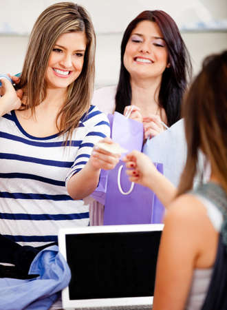 Female customer shopping and paying by credit or debit card at a store Stock Photo - 11466964